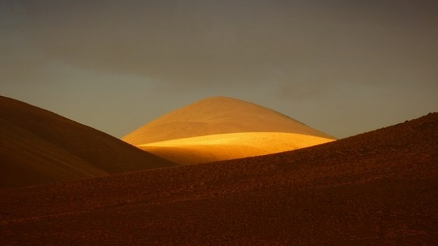 Sunlight andes golden sand mountain dessert hill Free Photo