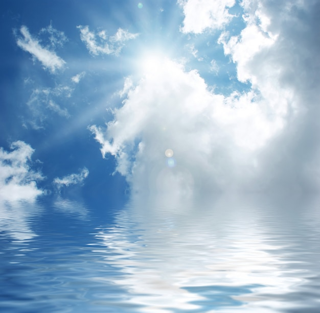 Sunny blue sky reflected in water Free Photo