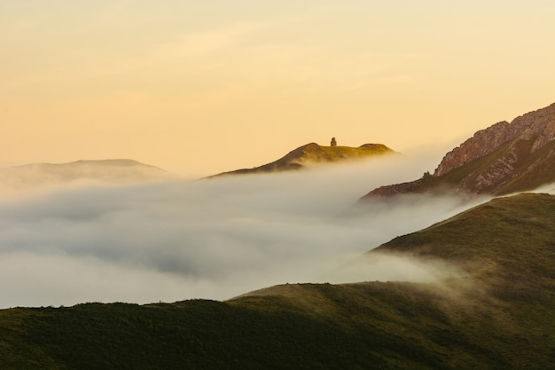 A sunny morning high in the mountains. fog on the hills. altai. dawn. Premium Photo