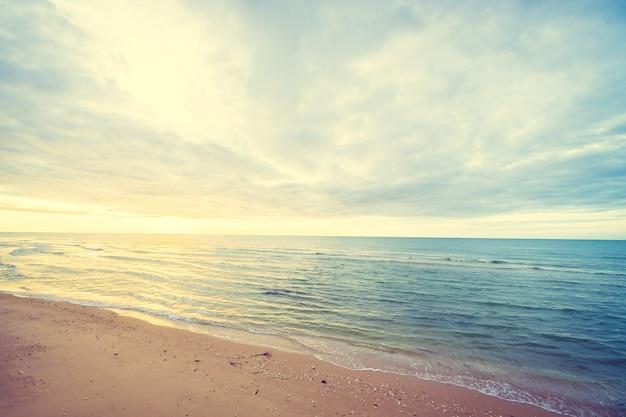 Sunrise on the beach and sea Free Photo
