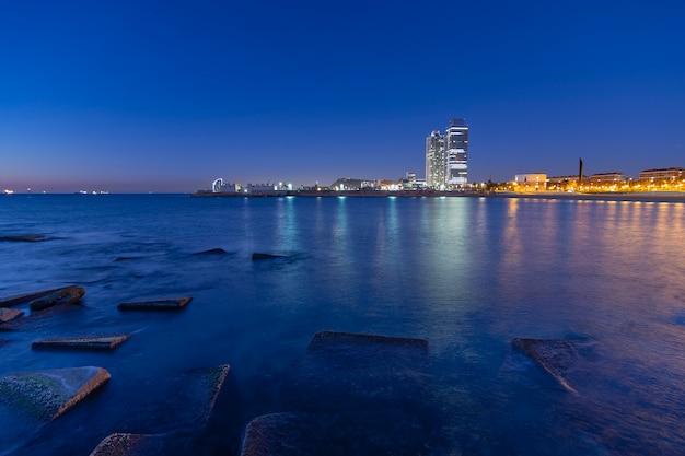 Sunrise on the city beach blue hour Premium Photo