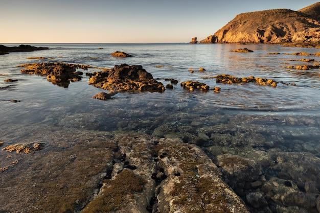 Sunrise on the coast of escullos. natural park of cabo de gata. almeria. spain. Premium Photo