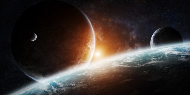 Sunrise over group of planets in space Premium Photo