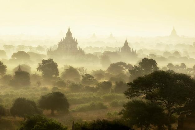 Sunrise scene at pagoda ancient city field in bagan myanmar. Premium Photo