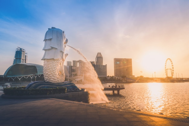 Sunrise of singapore skyline. singapore`s business distric on blue sky view Premium Photo