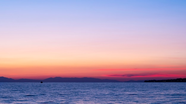 Sunset on the aegean sea, ship and land in the distance, water, greece Free Photo