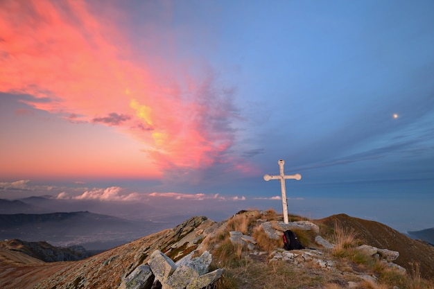 Sunset on the alps colorful cloudscape view from the top Premium Photo