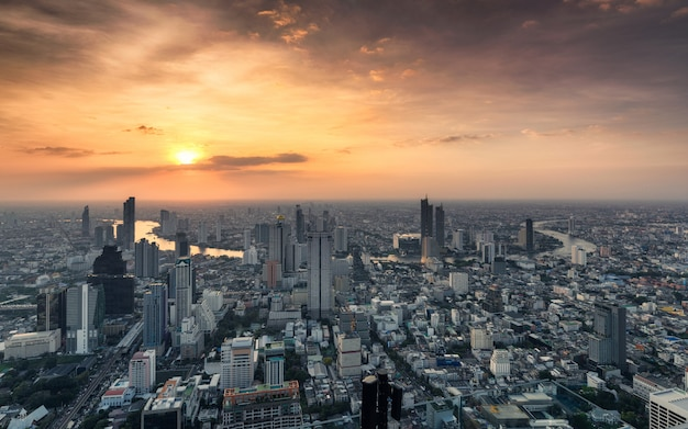 Sunset on crowded building with chao phraya river at bangkok city, thailand Premium Photo