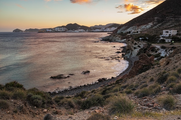 Sunset landscape in cala higuera. san jose. natural park of cabo de gata. spain. Premium Photo