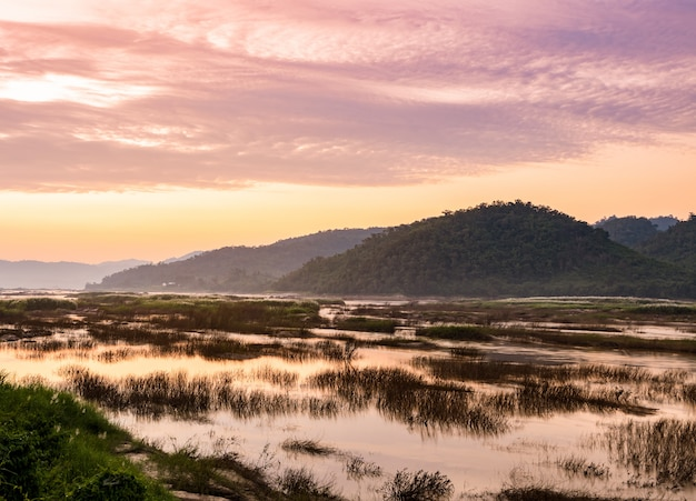 Sunset landscape of the dried up mekong river in northeast thailand. Premium Photo