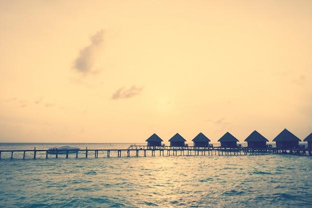 Sunset over maldives island Free Photo