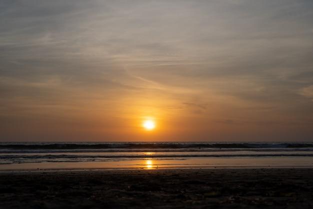 Sunset over an ocean Free Photo