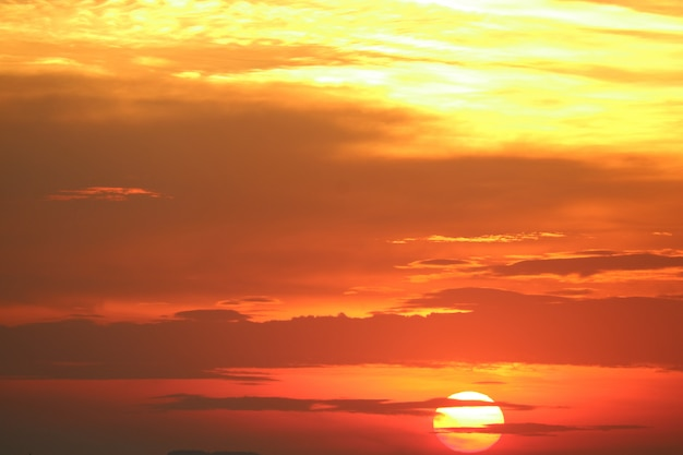 Sunset on red orange sky back soft evening cloud over horizon sea Premium Photo