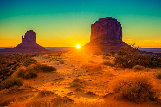 Sunset at the sisters in monument valley, usa Free Photo