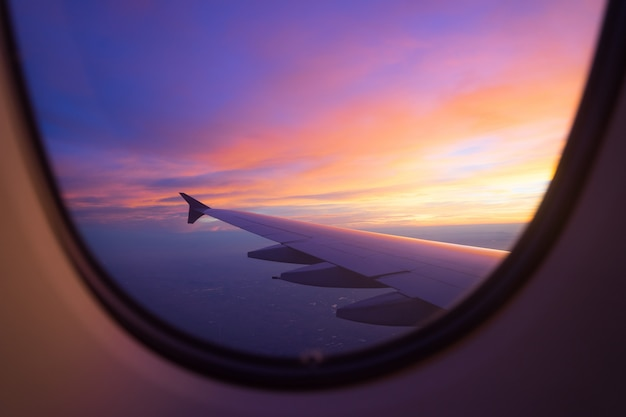 sunset-sky-from-airplane-window_117856-4