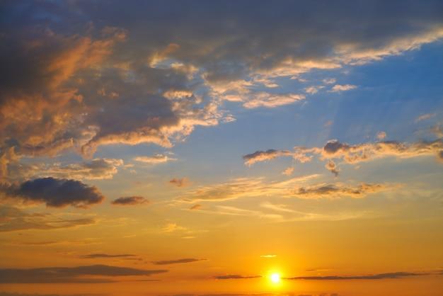 Sunset sky in orange and blue Premium Photo