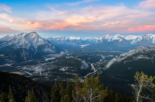 Sunset skyline of town of banff and bow valley, view from gondola sulphur mountain Premium Photo