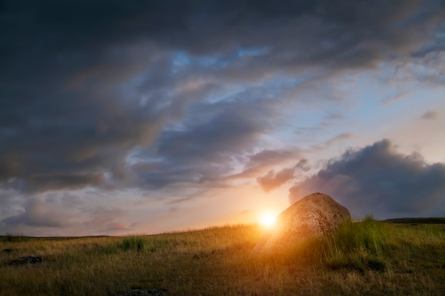 Sunset in the steppe, a beautiful evening sky Premium Photo