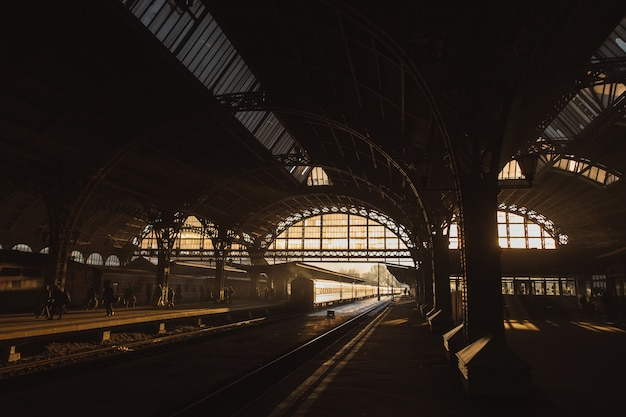 Sunset at train station Free Photo