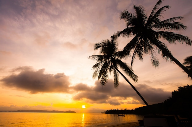 Sunset over tropical sea and beach. Premium Photo