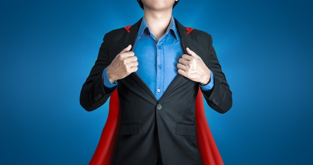 Super business man wears black suits and red robes Premium Photo