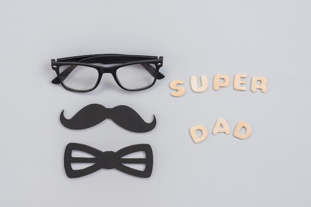 Super dad inscription with glasses and paper mustache Free Photo