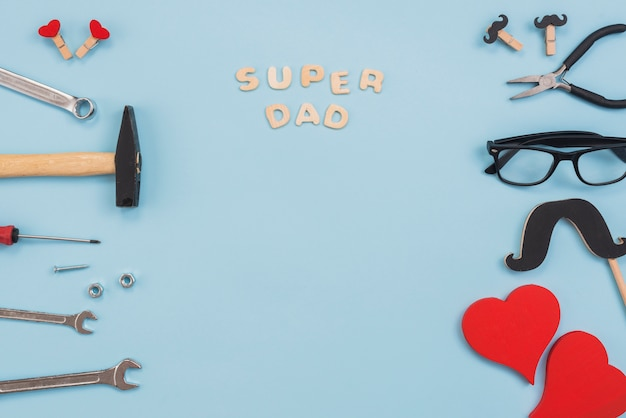 Super dad inscription with tools and glasses Free Photo