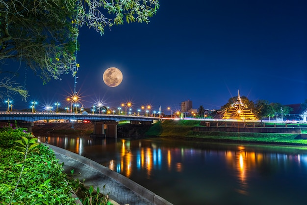 Super full moon over pagoda on the temple that is a tourist attraction Premium Photo