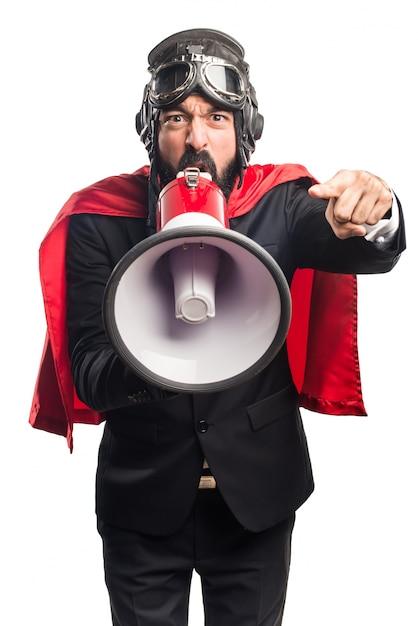 Super hero businessman shouting by megaphone Free Photo
