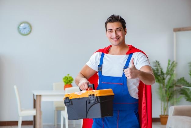Super hero repairman working at home Premium Photo