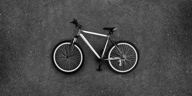 Super large photo of bike lying on the pavement. Premium Photo