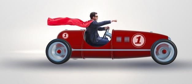 Superhero businessman driving vintage roadster Premium Photo