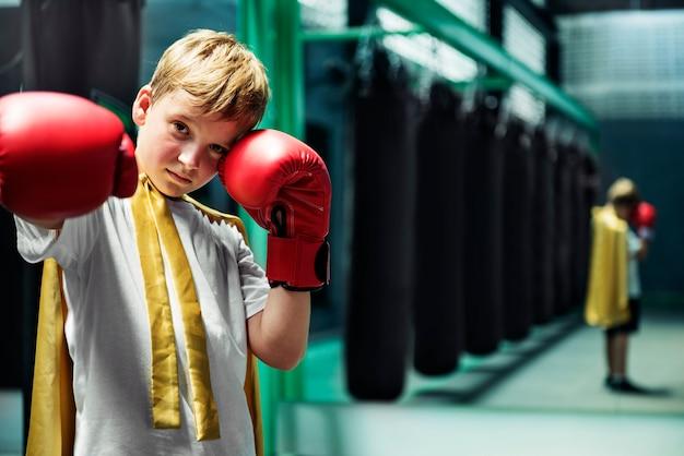 Superhero champion boxer boy strength fighter concept Free Photo