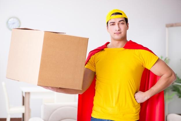 Superhero delivery guy with box Premium Photo