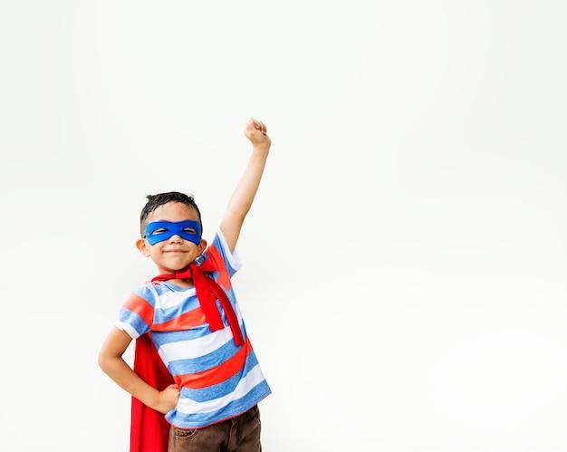 Superhero kid arms raised playful concept Premium Photo