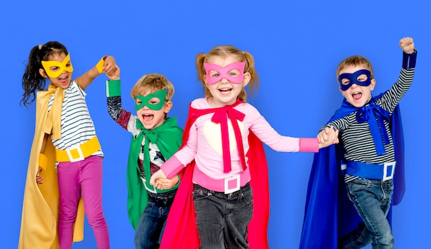 Superhero kids friendship smiling happiness playful togetherness Premium Photo