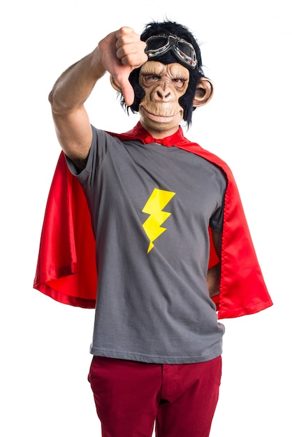 Superhero monkey man doing bad signal Free Photo