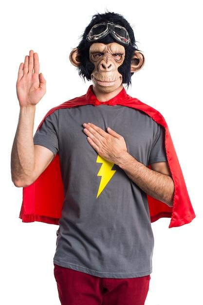 Superhero monkey man doing an oath Free Photo