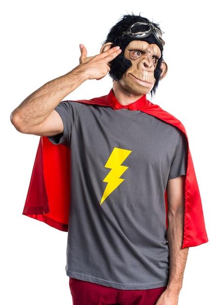 Superhero monkey man making suicide gesture Free Photo