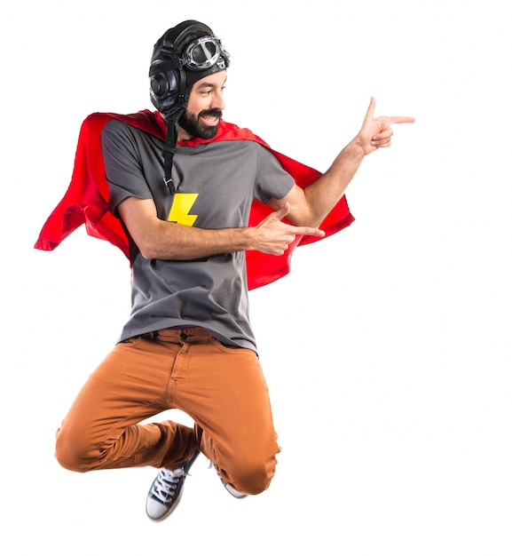 Superhero pointing to the lateral Free Photo