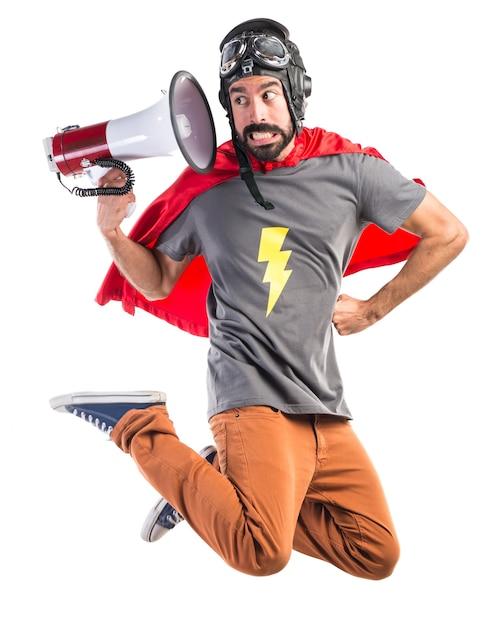 Superhero shouting by megaphone Free Photo