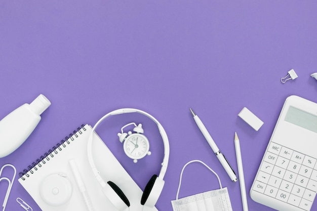 Supplies for school with purple background Free Photo
