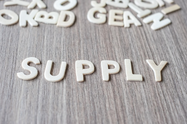 Supply word of wooden alphabet letters. business and idea concept Premium Photo