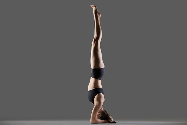 Supported headstand yoga pose Free Photo