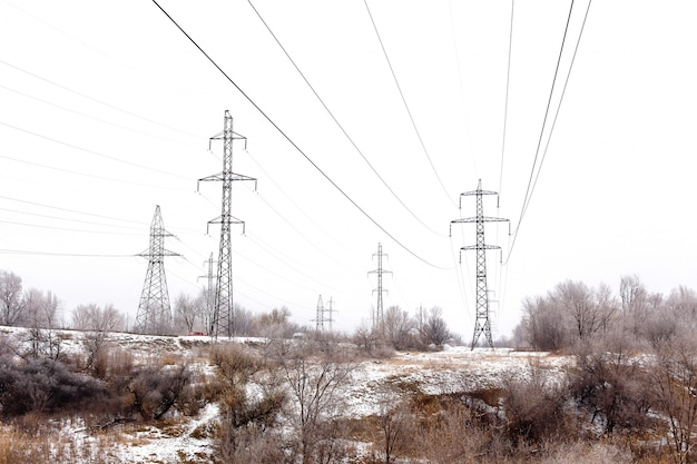 Supports high-voltage power lines in winter Premium Photo