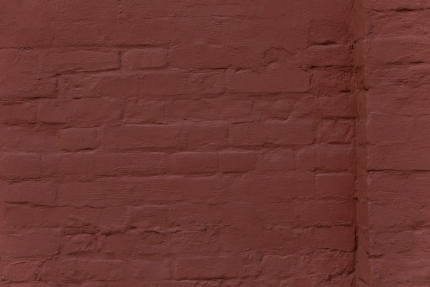 The surface of a brown brick wall with a ledge. background. space for text. Premium Photo