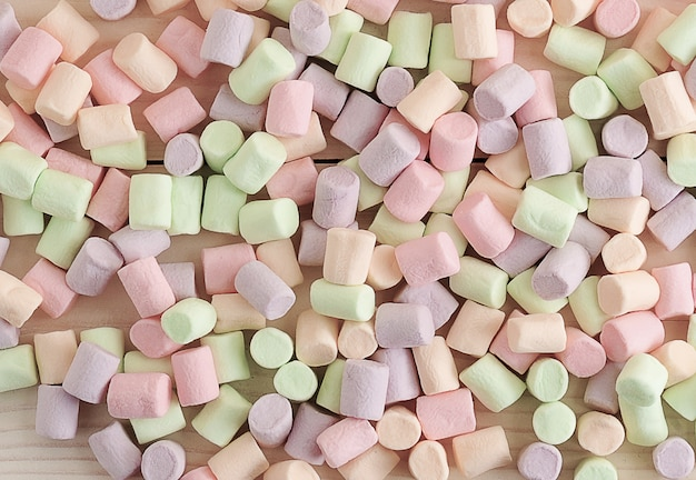 Surface from the scattered candy marshmallows Premium Photo