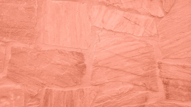 Surface of the stone wall with pink tint Free Photo