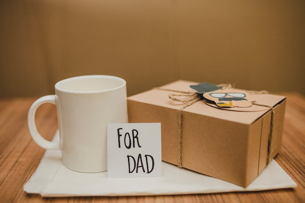 Surface with father's day gift and mug Free Photo