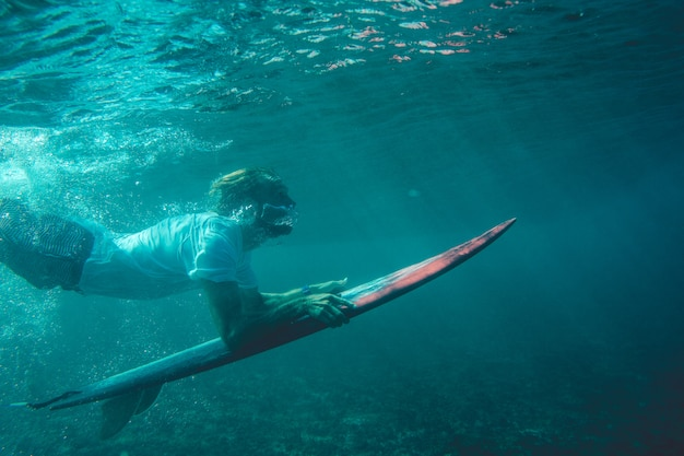 Surfer in the ocean Free Photo